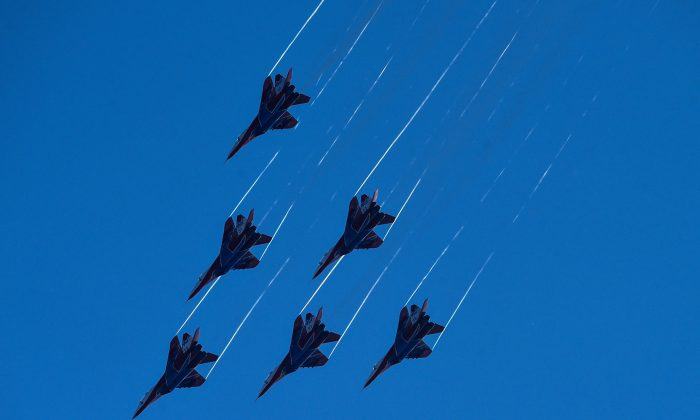 Russian aerobatic group Strizhi (Swifts) performs on MIG-29 jet fighters during the MAKS-2015, the International Aviation and Space Show, in Zhukovsky, outside Moscow, on August 25, 2015. (KIRILL KUDRYAVTSEV/AFP/Getty Images)