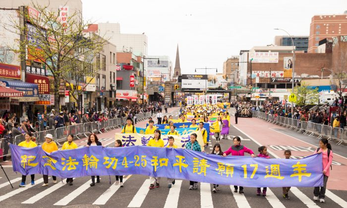 Falun Gong practitioners march in a parade in Flushing, New York, on April 23, 2016, calling for an end to the persecution of Falun Gong in China. (Larry Dye/Epoch Times)