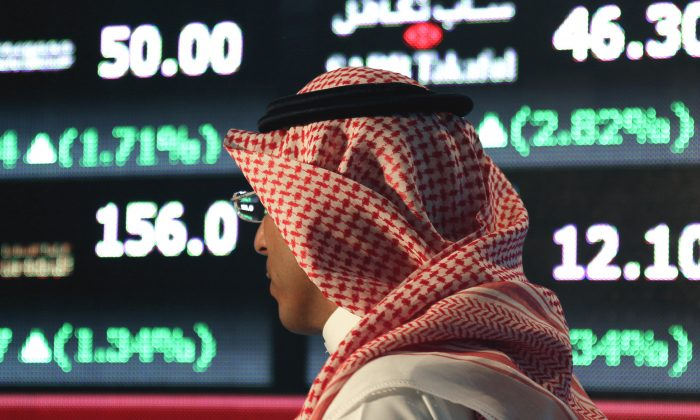 A Saudi man at the Tadawul Saudi Stock Exchange, in Riyadh, Saudi Arabia, on June 15, 2015. The Saudi economy is becoming undone by a low oil price and a strong dollar. (AP Photo/Hasan Jamali)