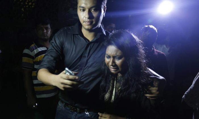 An unidentified co worker of U.S. Agency for International Development, (USAID) employee Xulhaz Mannan who was stabbed to death wails as she returns from the crime spot in Dhaka, Bangladesh, Monday, April 25, 2016. Unidentified assailants fatally stabbed two men in Bangladesh's capital Monday night, including a gay rights activist who also worked for the USAID police said, in the latest in a series of attacks targeting atheists, moderates and foreigners.(AP Photo)
