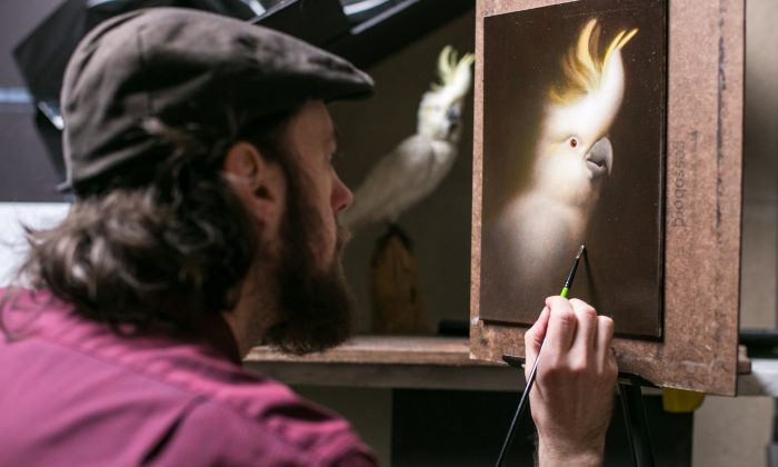 Artists Devin Cecil-Wishing, paints at the Grand Central Atelier in New York. (Benjamin Chasteen/Epoch Times)