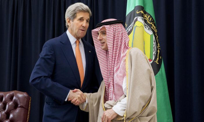 Saudi Foreign Minister Adel al-Jubeir (R) shakes hands with US Secretary of State John Kerry during a joint press conference after a meeting with foreign ministers from the six-nation Gulf Cooperation Council at King Salman airbase on January 23, 2016 in Riyadh.    (JACQUELYN MARTIN/AFP/Getty Images)