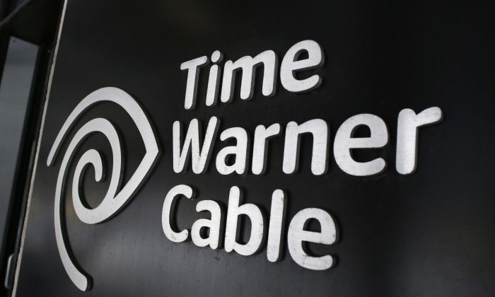 In this May 26, 2015, file photo, the Time Warner Cable corporate logo is displayed at a company store, in New York. (AP Photo/Mark Lennihan)