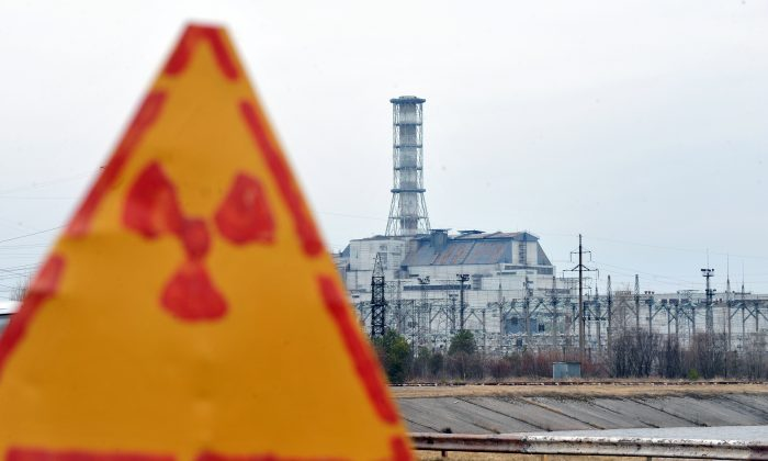 A radioactivity sign outside the fourth nuclear reactor at the former Chernobyl Nuclear power plant, site of the world's worst nuclear disaster,  is pictured on April 4, 2011. A project to build a new sarcophagus over the damaged Chernobyl nuclear reactor lacks some 600 million euros of the 1.5 billion needed, a Ukrainian official said said last week.  The concrete sarcophagus capping the reactor has developed cracks over the past 25 years and is not considered failsafe. AFP PHOTO / SERGEI SUPINSKY (Photo credit should read SERGEI SUPINSKY/AFP/Getty Images)