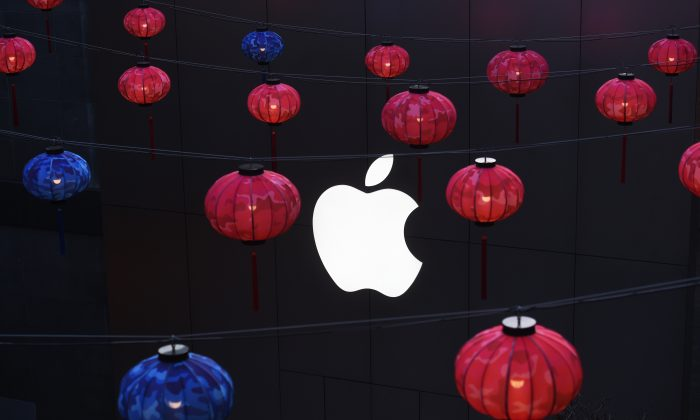 Lanterns hang outside an Apple store in a mall in Beijing on February 23, 2016. (Greg Baker/AFP/Getty Images)