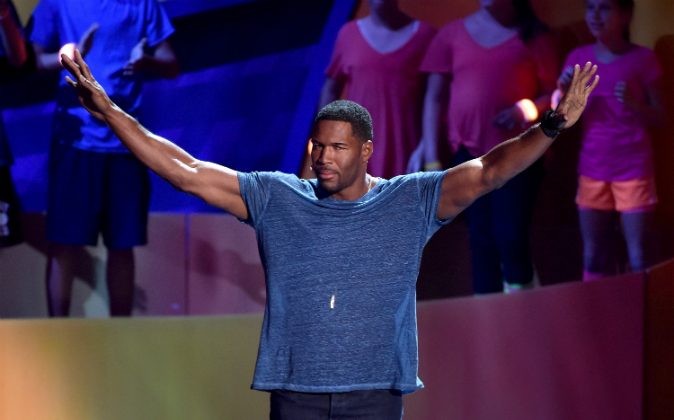 TV personality Michael Strahan speaks onstage at the Nickelodeon Kids' Choice Sports Awards 2015 at UCLA's Pauley Pavilion on July 16, 2015 in Westwood, California. (Photo by Kevin Winter/Getty Images)
