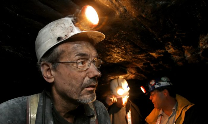 Peabody Energy's Gateway Mine coal miners Donny Maddox, a section foreman, monitors work in his area of the Gateway Mine, near Coulterville, Ill., on March 9, 2006. (AP Photo/Seth Perlman)