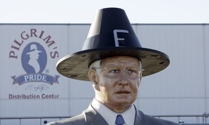 FILE - In this Dec. 2, 2008 file photo, a statue of Pilgrim's Pride founder Bo Pilgrim is displayed outside the distribution center near Pittsburg, Texas. Brazilian beef producer JBS SA on Wednesday, Sept. 16, 2009 said it will buy a majority stake in Pilgrim's Pride for $800 million, in a deal that includes paying off Pilgrim's Pride's creditors in full and distributing new stock to current shareholders _ something unusual for a company in bankruptcy protection. (AP Photo/LM Otero, file)