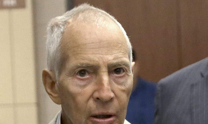 In this Aug. 15, 2014 file photo, New York City real estate heir Robert Durst leaves a Houston courtroom. New Orleans Federal Judge Kurt Engelhardt on Wednesday, April 27, 2016, approved a plea agreement for Durst to serve 7 years, 1 month in prison on a weapons charge. Durst still faces a separate murder charge in California. (AP Photo/Pat Sullivan, File)