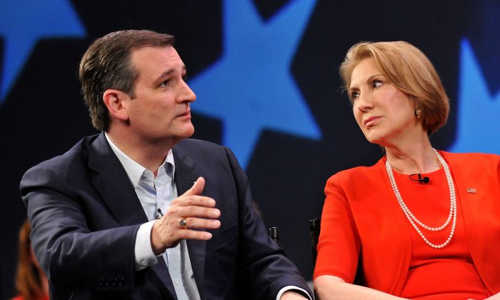 Republican presidential candidate Sen. Ted Cruz  (R-TX) and former candidate Carly Fiorina (L) in a discussion with political commentator Sean Hannity during a campaign rally at Faith Assembly of God Church on March 11, 2016 in Orlando, Florida. The candidates continue to campaign before the March 15th Florida primary.  (Photo by Gerardo Mora/Getty Images)