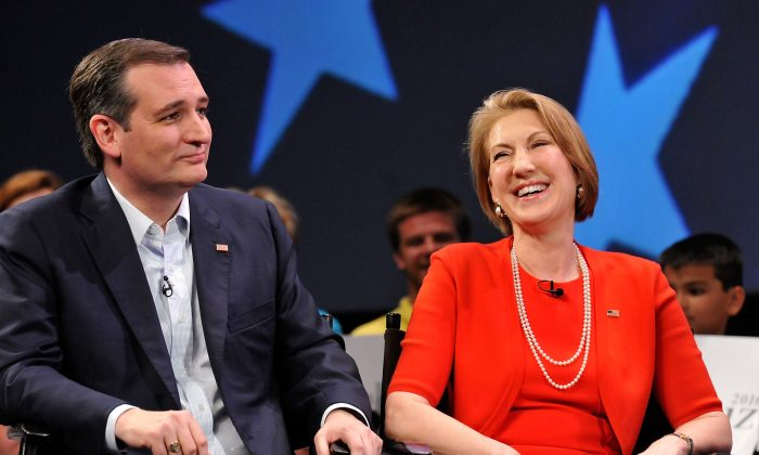 Republican presidential candidate Sen. Ted Cruz (R-TX) and former candidate Carly Fiorina (L) in a discussion with political commentator Sean Hannity during a campaign rally at Faith Assembly of God Church on March 11, 2016, in Orlando, Fla. (Gerardo Mora/Getty Images)