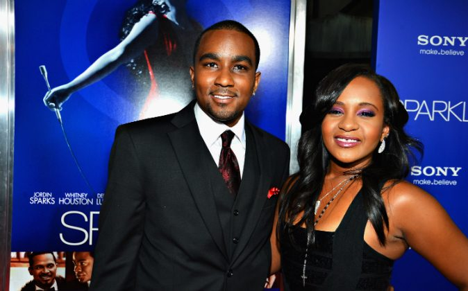 """Bobbi Kristina Brown (R) and Nick Gordon arrive at Tri-Star Pictures' 'Sparkle' premiere at Grauman's Chinese Theatre on August 16, 2012 in Hollywood, California. Gordon was found """"legally responsible"""" in the death of Brown on Sept. 16. (Frazer Harrison/Getty Images)"""