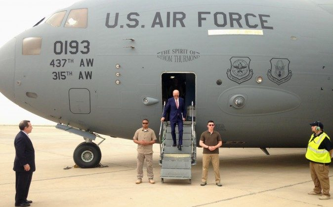 Vice President Joe Biden steps off a C-17 military transport plane upon his arrival in Baghdad, Iraq, Thursday, April 28, 2016. Biden arrived in Baghdad on a visit intended to help Iraqi leaders resolve a political crisis that has hindered efforts to defeat the Islamic State group.  (AP Photo/Josh Lederman)