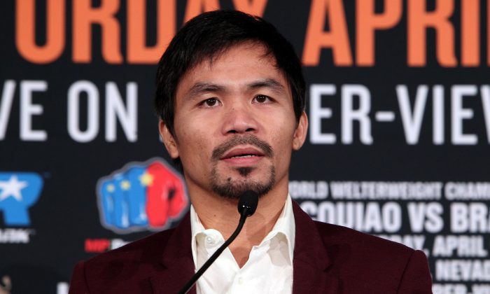 Boxer Manny Pacquiao speaks during a press conference with opponent Timothy Bradley announcing their upcoming 12-round world welterweight championship at the Beverly Hills Hotel in Beverly Hills, California, January 19, 2016. (Chris Farina/AFP/Getty Images)