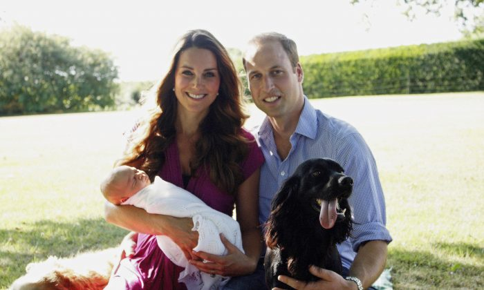 Catherine, Duchess of Cambridge and Prince William, Duke of Cambridge pose for a photograph with their son, Prince George Alexander Louis of Cambridge, surrounded by Lupo, the couple's cocker spaniel, and Tilly the retriever (a Middleton family pet) in the garden of the Middleton family home in August 2013 in Bucklebury, Berkshire.  (Michael Middleton - WPA Pool/Getty Images)