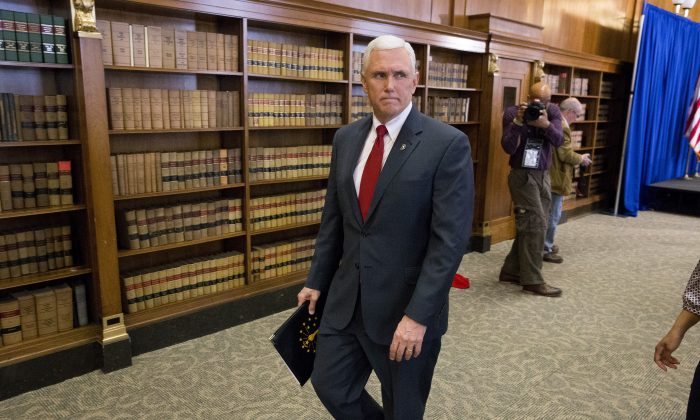 Indiana Gov. Mike Pence leaves a press conference March 31, 2015 at the Indiana State Library in Indianapolis, Indiana. (Photo by Aaron P. Bernstein/Getty Images)
