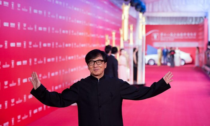 Hong Kong actor Jackie Chan poses on the red carpet during the opening ceremony of the Shanghai International Film Festival (SIFF) in Shanghai on June 13, 2015.  (JOHANNES EISELE/AFP/Getty Images)