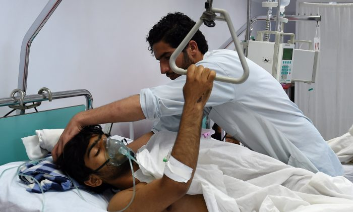 A wounded staff member of Doctors Without Borders (MSF), survivor of the US airstrikes on the MSF Hospital in Kunduz, receives treatment at the Italian aid organization, Emergency's hospital in Kabul on Oct. 6, 2015. (Wakil Kohsar/AFP/Getty Images)