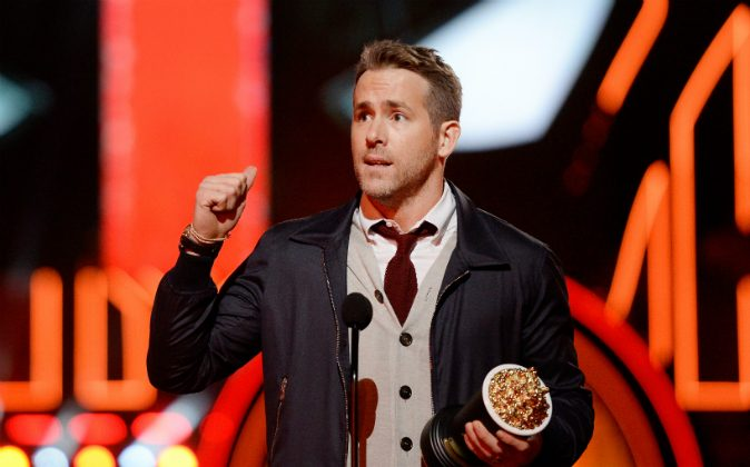 ctor Ryan Reynolds accepts Best Comedic Performance for 'Deadpool' onstage during the 2016 MTV Movie Awards at Warner Bros. Studios on April 9, 2016 in Burbank, California. MTV Movie Awards airs April 10, 2016 at 8pm ET/PT. (Photo by Kevork Djansezian/Getty Images)
