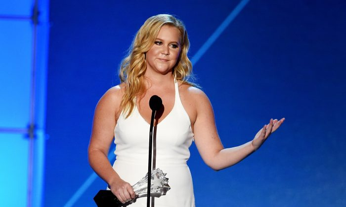 Actress-writer Amy Schumer accepts Critics' Choice MVP Award onstage during the 21st Annual Critics' Choice Awards at Barker Hangar on January 17, 2016 in Santa Monica, California.  (Kevin Winter/Getty Images)