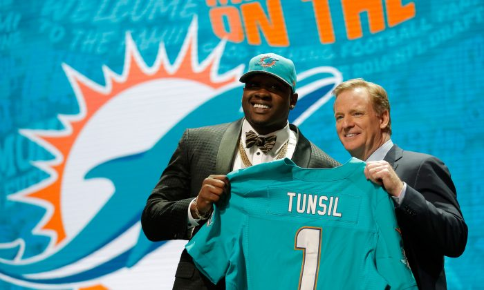 Former Ole Miss tackle Laremy Tunsil was selected by the Miami Dolphins with the 13th pick. (Jon Durr/Getty Images)