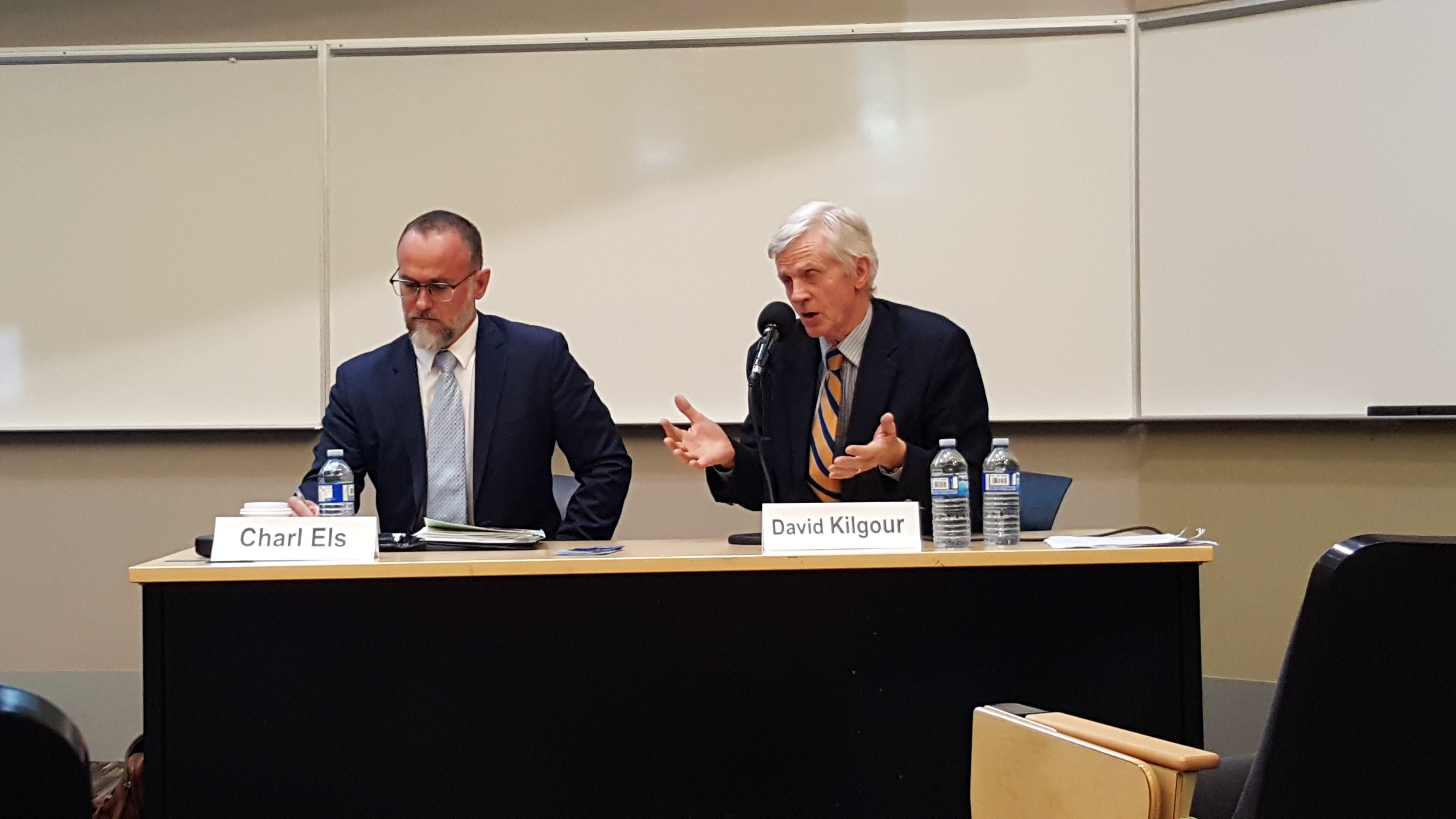 Dr. Charl Els (L), associate professor at the University of Alberta's department of psychiatry and the John Dossetor Health Ethics Centre, and David Kilgour, former Edmonton MP and secretary of state for Asia-Pacific, take part in a panel discussion following the screening of