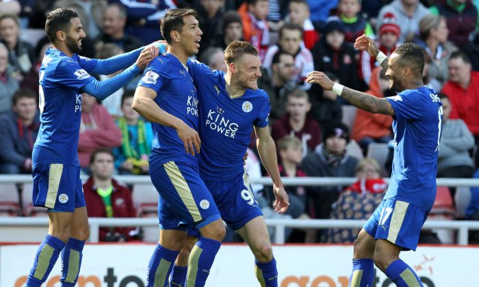 Leicester City striker Jamie Vardy celebrates scoring against Sunderland with Leonardo Ulloa, Riyad Mahrez, and Danny Simpson at the Stadium of Light in Sunderland on April 10, 2016. (Lindsey Parnaby/AFP/Getty Images)