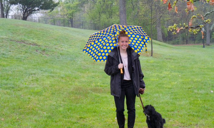 Goshen Girl Scout Kelly Fellenzer, 16, on May 1, 2016 walks her dog Shadow in Salesian Park in Goshen behind the Salesian seminary where she is planning a dog park for her Girl Scout Gold Award. (Holly Kellum/Epoch Times)