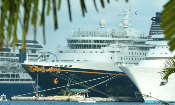 The Disney Wonder cruise ship is shown in Nassau Harbor in the Bahamas, Friday, Dec. 27, 2002. (AP Photo/Tim Aylen)