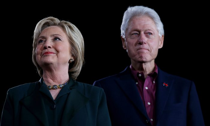 """Democratic presidential candidate former Secretary of State Hillary Clinton and her husband, former U.S. president Bill Clinton look on during a """"Get Out The Caucus"""" at the Clark County Government Center on February 19, 2016 in Las Vegas, Nevada. (Justin Sullivan/Getty Images)"""