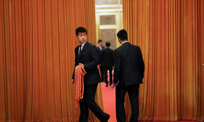 A security agent at the Great Hall of the People in Beijing, China, on April 28, 2016. (Damir Sagolj/Getty Images)