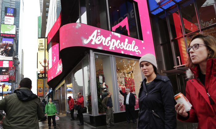In this Wednesday, Dec. 2, 2015, file photo, women pass an Aeropostale clothing store in New York's Times Square. Aeropostale, once the vibrant epicenter of the U.S. mall scene, announced Wednesday, May 4, 2016, it is seeking Chapter 11 bankruptcy protection. (AP Photo/Mark Lennihan, File)