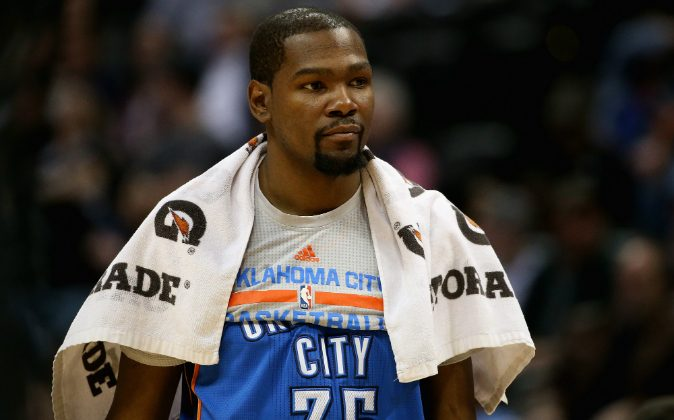 Kevin Durant #35 of the Oklahoma City Thunder looks on from the bench late in the game against the Denver Nuggets at Pepsi Center on April 5, 2016 in Denver, Colorado. (Photo by Doug Pensinger/Getty Images)