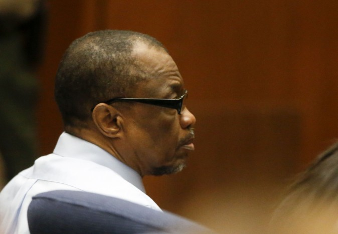 Lonnie Franklin Jr., left, appears in Los Angeles Superior Court during closing arguments of his trail Monday, May 2, 2016, in Los Angeles. The Grim Sleeper serial killer trial is coming to a close in Los Angeles after months of testimony. Franklin is charged with killing nine women and a 15-year-old girl between 1985 and 2007. They were shot or strangled and their bodies dumped in alleys and trash bins in South Los Angeles and nearby areas. (Mark Boster/Los Angeles Times via AP, Pool)