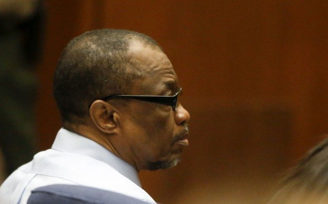 "Lonnie Franklin Jr., left, appears in Los Angeles Superior Court during closing arguments of his trail Monday, May 2, 2016, in Los Angeles. The ""Grim Sleeper"" serial killer trial is coming to a close in Los Angeles after months of testimony. Franklin is charged with killing nine women and a 15-year-old girl between 1985 and 2007. They were shot or strangled and their bodies dumped in alleys and trash bins in South Los Angeles and nearby areas. (Mark Boster/Los Angeles Times via AP, Pool)"