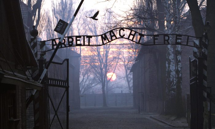 """The main gate of the former Nazi death camp of Auschwitz-Birkenau, with the lettering """"Arbeit macht frei"""" (Work makes you free), in Oswiecim, Poland, on Jan. 13, 2005. (Janek Skarzynski/AFP/Getty Images)"""