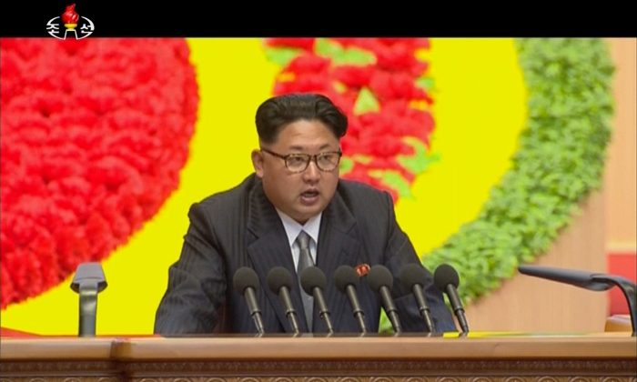 "In this image made from video by North Korean broadcaster KRT, North Korean leader Kim Jong Un speaks at the party congress in Pyongyang, North Korea, Saturday, May 7, 2016. North Korea will not use its nuclear weapons first unless its sovereignty is invaded, state media on Sunday, May 8, quoted Kim as saying during a critical ruling party congress. Kim also said he is ready to improve ties with ""hostile"" nations in a diplomatic overture in the face of international pressure over its recent nuclear test and long-range rocket launch. He called for more talks with rival South Korea to reduce misunderstanding and distrust between them and urged the United States to stay away from inter-Korean issues, according to the official Korean Central News Agency. (KRT via AP Video) NORTH KOREA OUT"