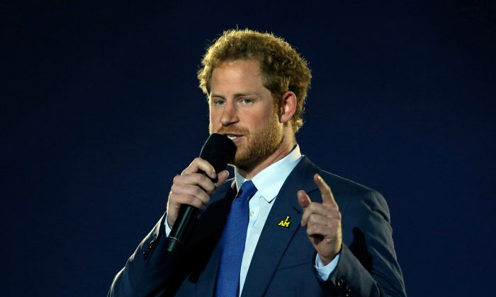 Britain's Prince Harry addresses the audience during the opening ceremony for the Invictus Games, Sunday, May 8, 2016, in Kissimmee, Fla. (AP Photo/John Raoux)