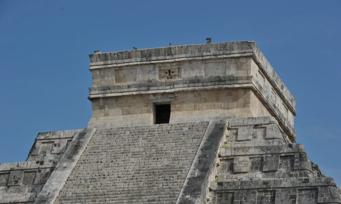 Picture of the top of the Kukulcan temple, also known as El Castillo (The Castle), a step pyramid dominating Chichen Itza archaeological site - a complex built by the Mayan civilization in the Yucatan Peninsula, in the Mexican state of Yucatan, taken on December 2, 2010. (Cris Bouroncle/AFP/Getty Images)