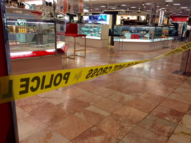 Crime scene tape is seen inside the Macy's at the Silver City Galleria mall in Taunton, Mass., Tuesday, May 10, 2016. Multiple people have been stabbed separate attacks at the mall and a home in Massachusetts. (Charles Winokoor/The Daily Gazette via AP) MANDATORY CREDIT