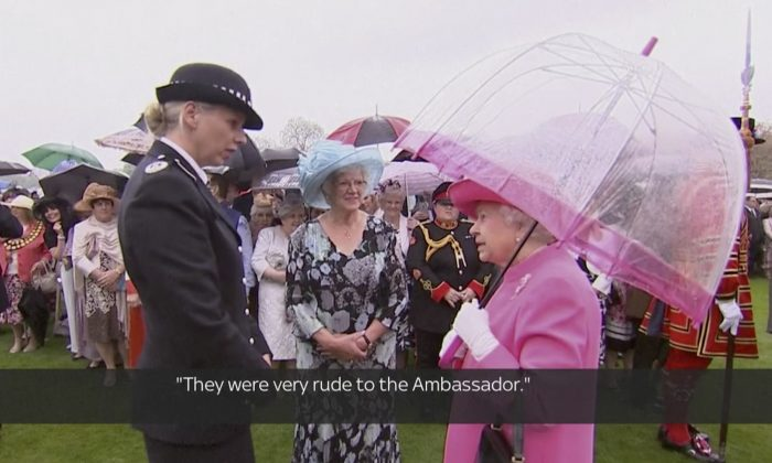"In image made from pool video, Queen Elizabeth II speaks with Metropolitan Police Commander Lucy D'Orsi in the garden of Buckingham Palace in London, Tuesday, May 10, 2016. Queen Elizabeth II has been overheard on video describing Chinese officials as ""very rude to the ambassador"" in a conversation with a senior police officer at a Buckingham Palace event celebrating her birthday. Subtitles as appears on source video. (Image from Pool Video via AP Video)"