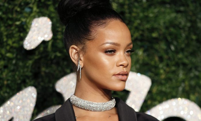 Barbadian pop star Rihanna poses for pictures on the red carpet upon arrival to attend the British Fashion Awards 2014 in London on December 1, 2014. (Justin Tallis/AFP/Getty Images)