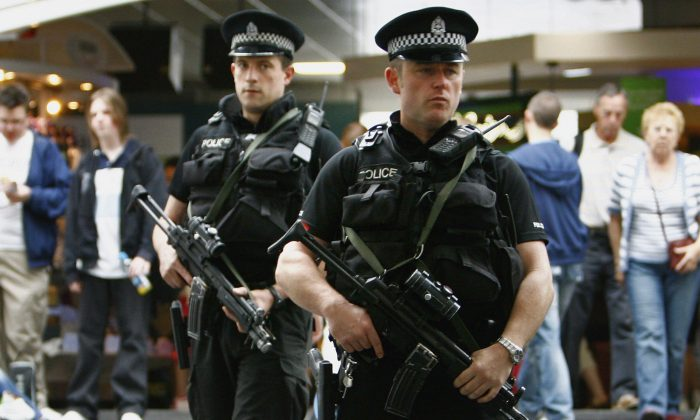 Armed police patrol Glasgow Airport as the UK terror alert remains at a critical level June 2, 2007 in Glasgow, Scotland. (Photo by Jeff J Mitchell/Getty Images)