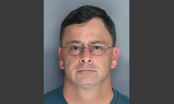 In this March 6, 2016 photo provided by the Berkeley County jail, Goose Creek, S.C. shows James Edward Loftis. Loftis faces two counts of murder after being accused of fatally shooting two people who were demanding an unpaid cab fare. (Berkeley County jail via AP)