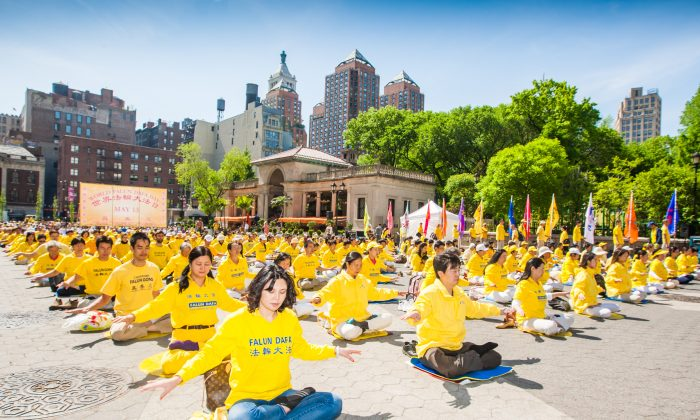 Falun Gong practitioners meditate at Union Square in New York as they celebrate World Falun Dafa Day on May 12, 2016. (Youzhi Ma/Epoch Times)