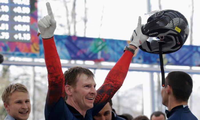 Pilot Alexander Zubkovof Russia team 1 celebrates winning the gold medal during the Men's Four-Man Bobsleigh on Day 16 of the Sochi 2014 Winter Olympics at Sliding Center Sanki on February 23, 2014 in Sochi, Russia.  (Photo by Adam Pretty/Getty Images)