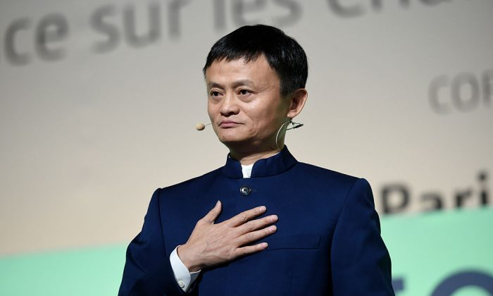 """Chief Executive Officer of the Alibaba Group Jack Ma (Ma Yun) delivers a speech during the """"Action Day"""" at the COP21 United Nations conference on climate change in Le Bourget on December 5, 2015. (ERIC FEFERBERG/AFP/Getty Images)"""