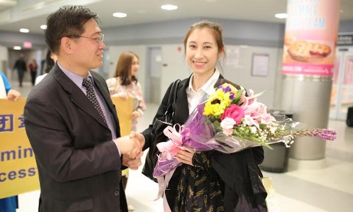 Rachel Bastick (R), a soprano, principal dancer, and director of Shen Yun's Touring Company, on May 11 at JFK. (Bing Gan/Epoch Times)