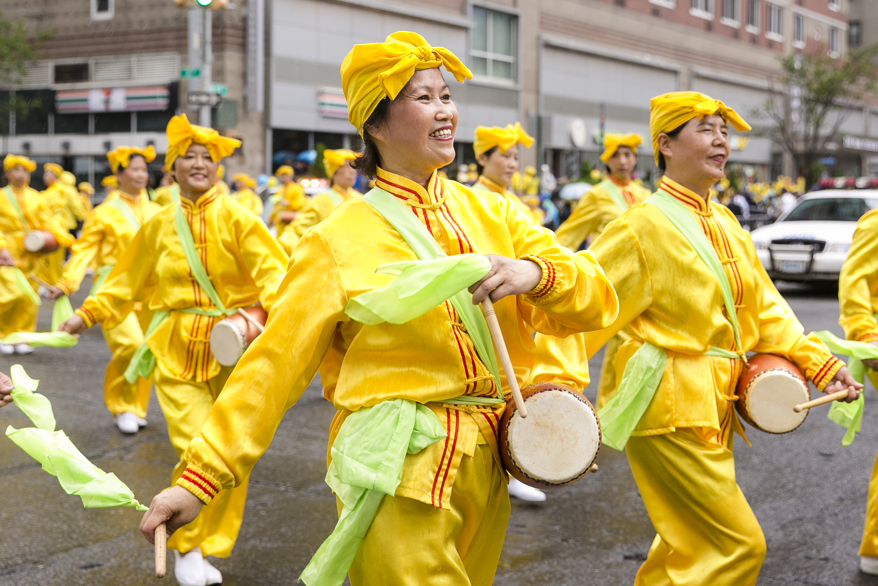 A Falun Gong waist drum troupe performs in the World Falun Dafa Day parade along 42nd Street in New York, on May 13, 2016. (Samira Bouaou/Epoch Times)