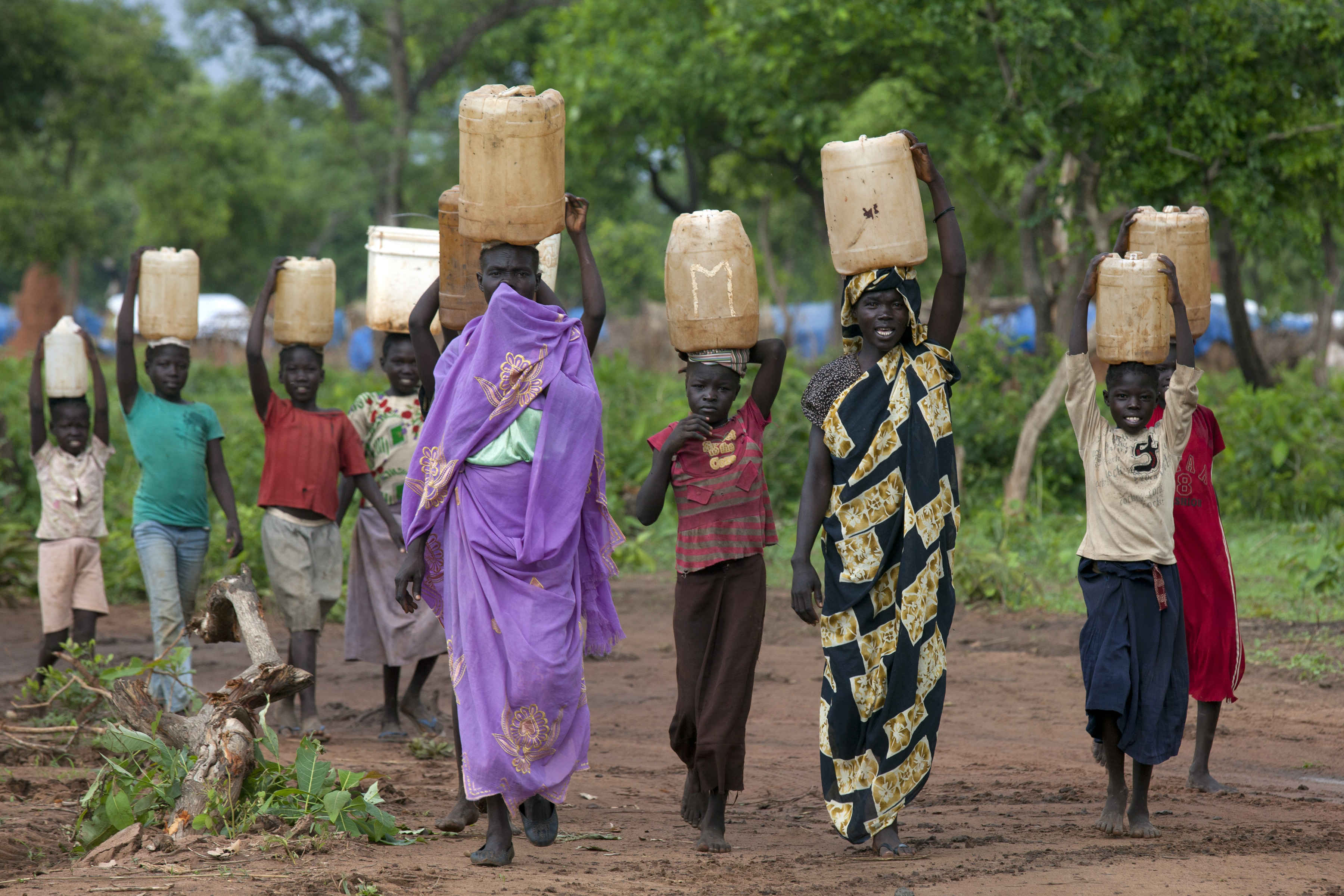 Sudanese women and children carry water at the Yida refugee camp along the border with Sudan, in Yida, South Sudan, on June 30, 2012. (Paula Bronstein/Getty Images)